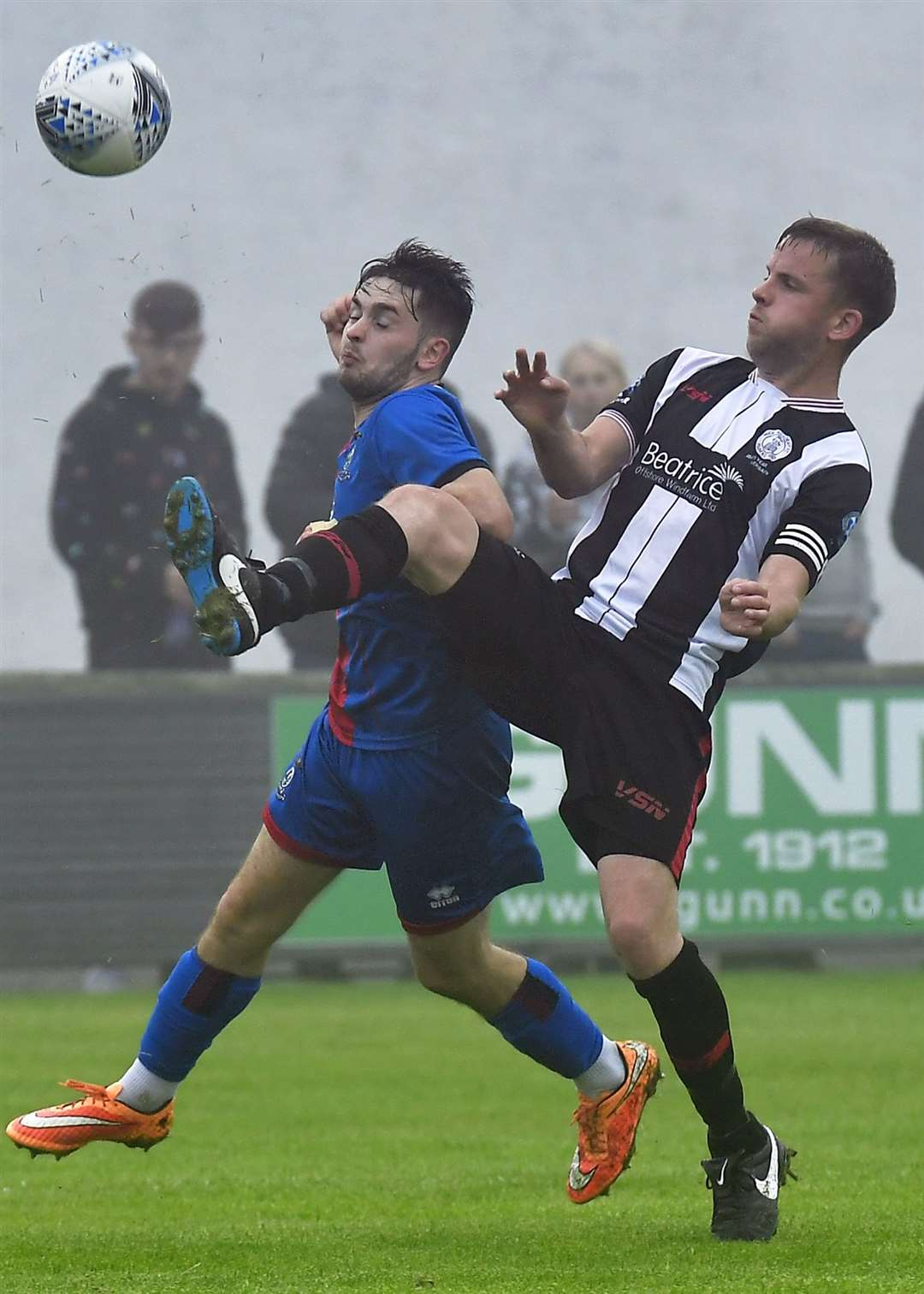Wick's Alan Farquhar clears the ball from Inverness Caley Thistle's Roddy Kennedy. Picture: Mel Roger