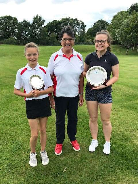 The girls' champions at Muir of Ord, handicap winner Mikayla Mackay (left), of Royal Dornoch, and Reay's Mollie O'Brien (right), with Liz Munro, the north women's president.