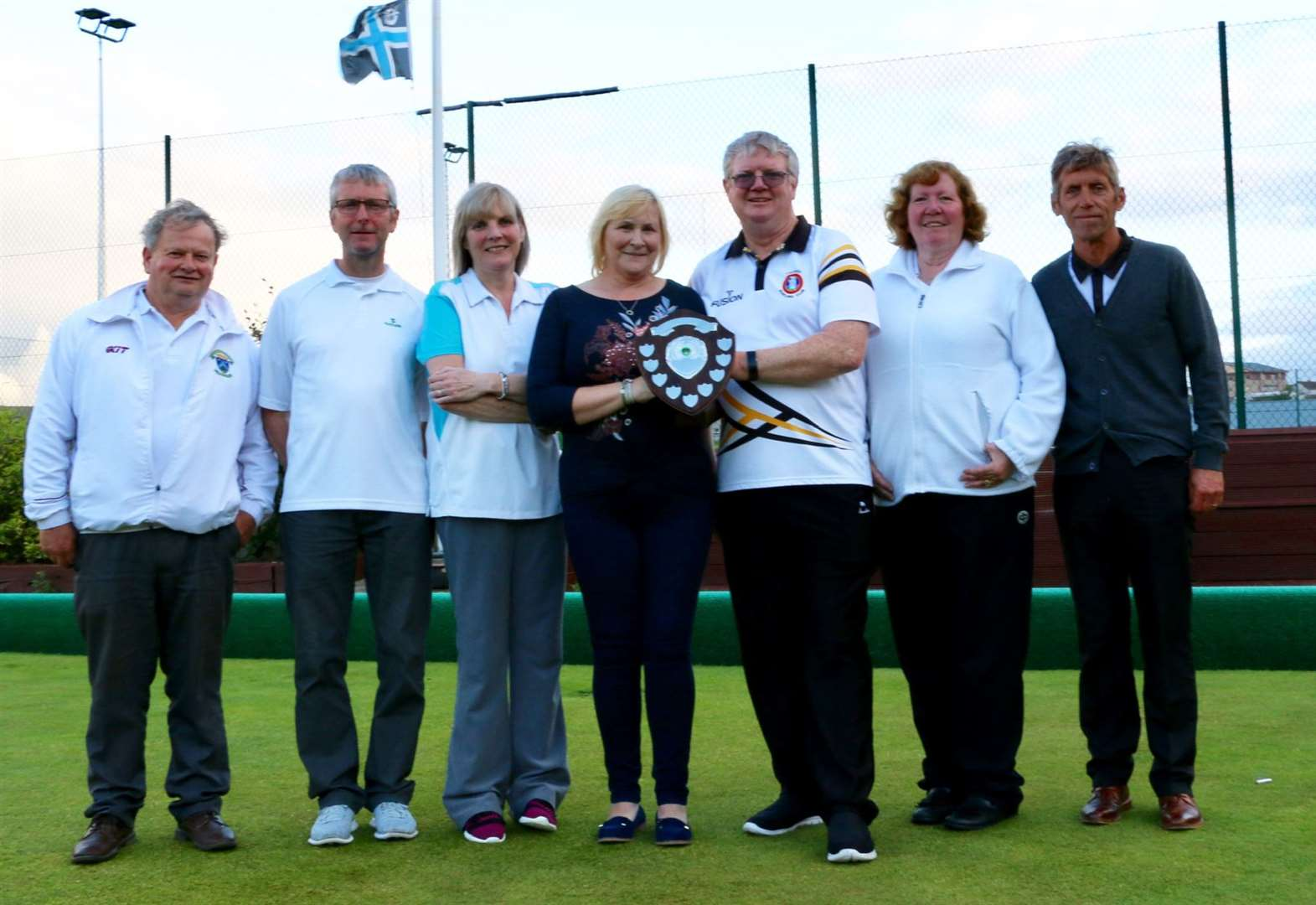 Douglas's final bowl secures over-50s' triples victory
