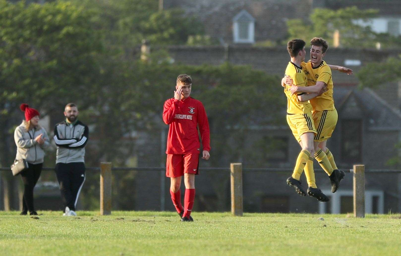 Grant Aitkenhead and Kyle Henderson celebrate a goal for Staxigoe United against Wick Groats.