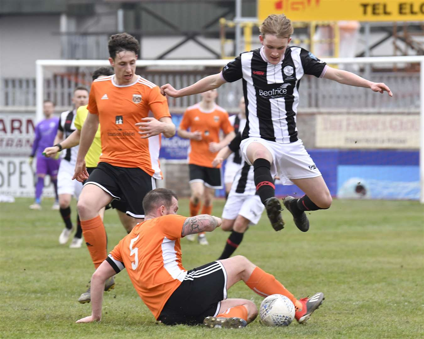 Wick's Mark Macadie hurdles a challenge from Jamie Duff of Rothes during Saturday's Highland League match at Mackessack Park. Picture: Bob Roger
