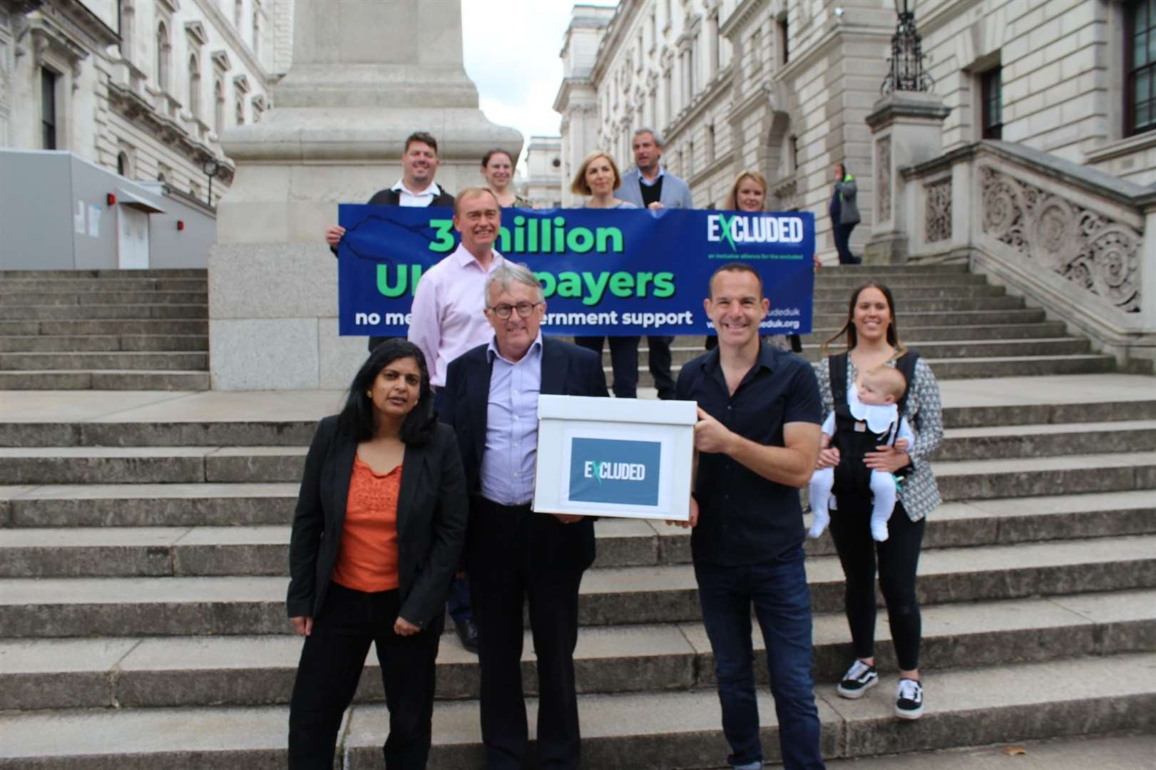 Jamie Stone with Martin Lewis and those who started the petition.