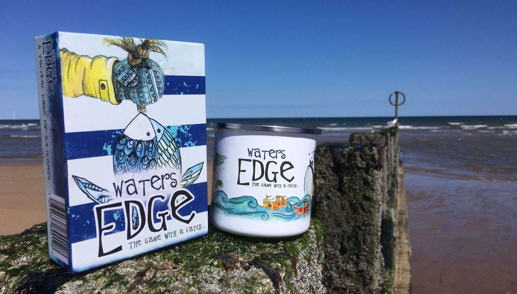 Waters Edge features illustrated cards which link together to create a town where players catch and sell fish to gain points.