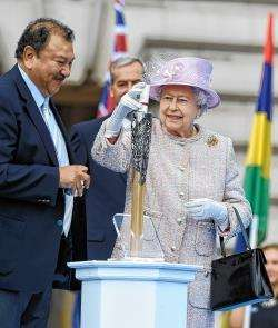 The Queen places her message in the baton before the relay's launch last October.