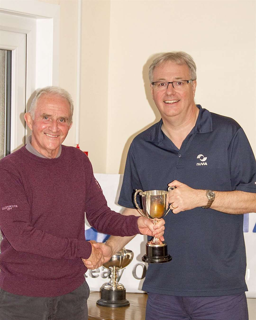 David Craig (right), business director of Nuvia, presenting the handicap trophy to Fred Groves.