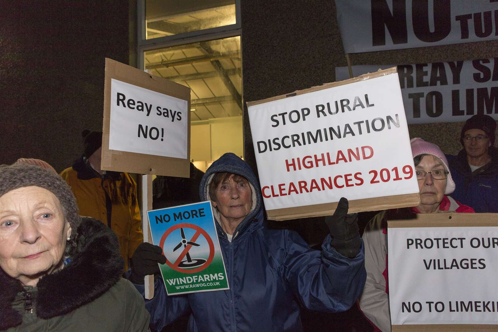 Placards make clear the strength of feeling among the protesters at Reay on Wednesday evening. Picture: Robert MacDonald / Northern Studios
