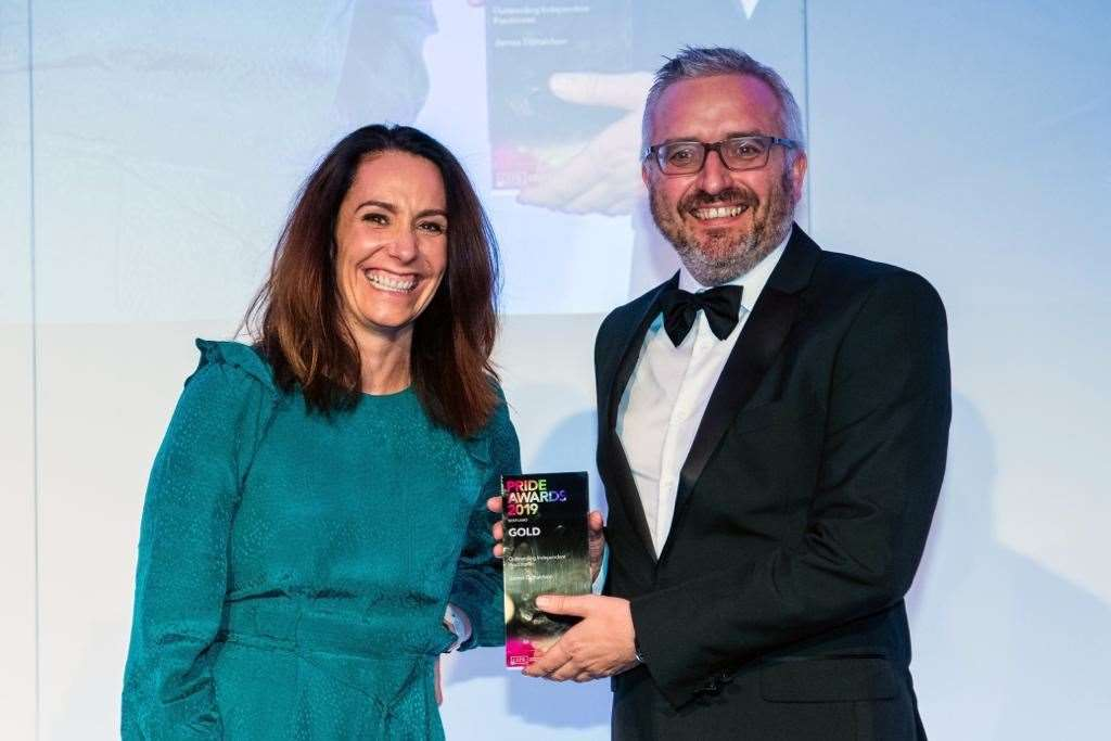 Kirsty Leiper, one of the event judges, presents Engage PR's James Donaldson with the gold accolade for Outstanding Independent Practitioner at the CIPR Scotland PRide Awards 2019 in Glasgow. Picture: Ian Georgeson