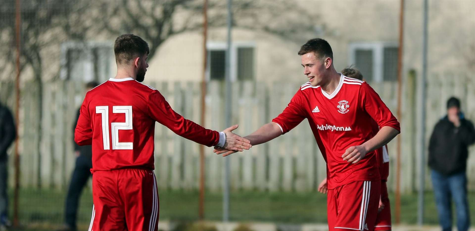 Michael Petrie (left) congratulates Conor Trueman on scoring for Thurso in the runaway win against Bonar. Picture: James Gunn