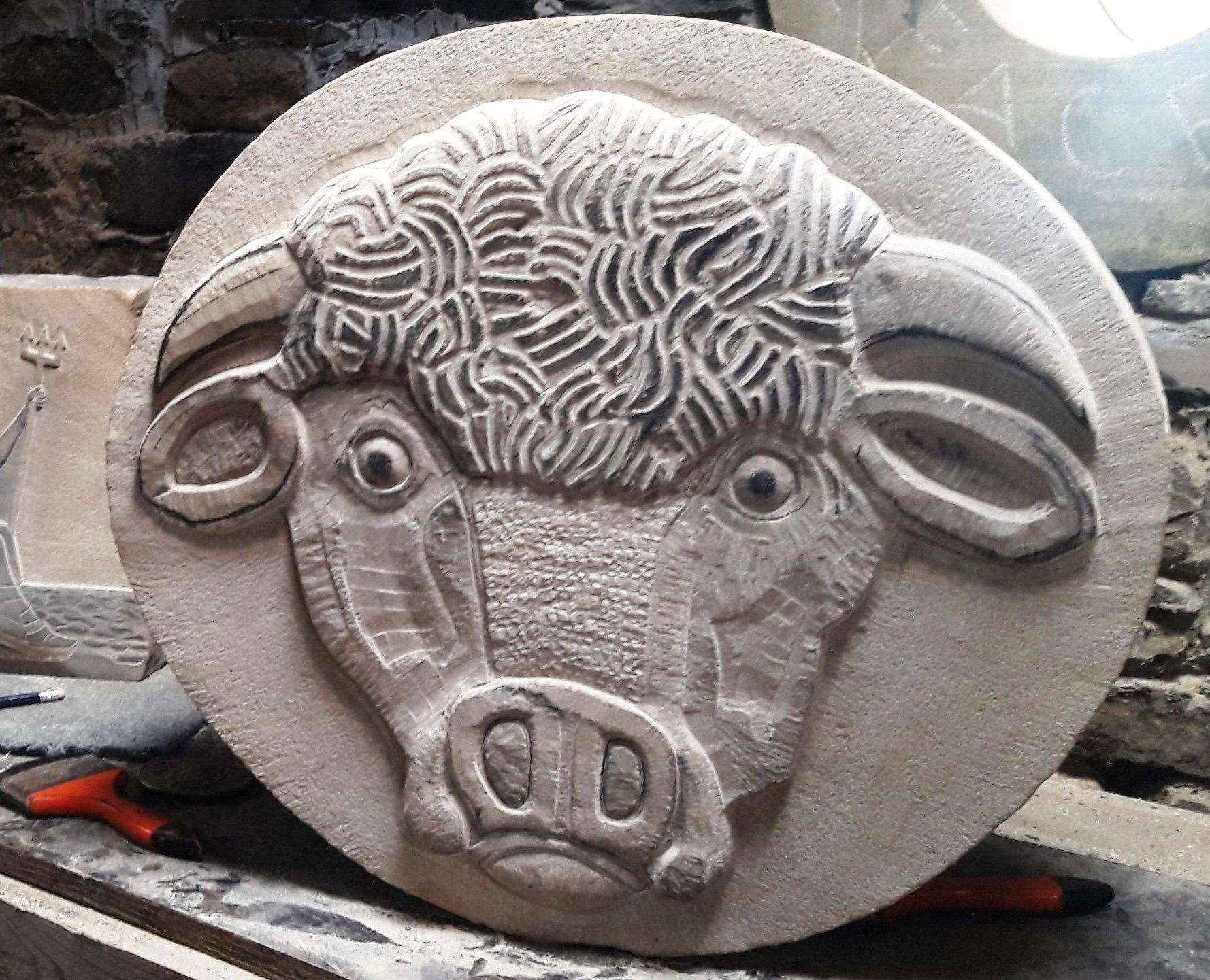 Stolen from Mid Clyth the stone carving shows a Highland cow. Weighs around 100kg.