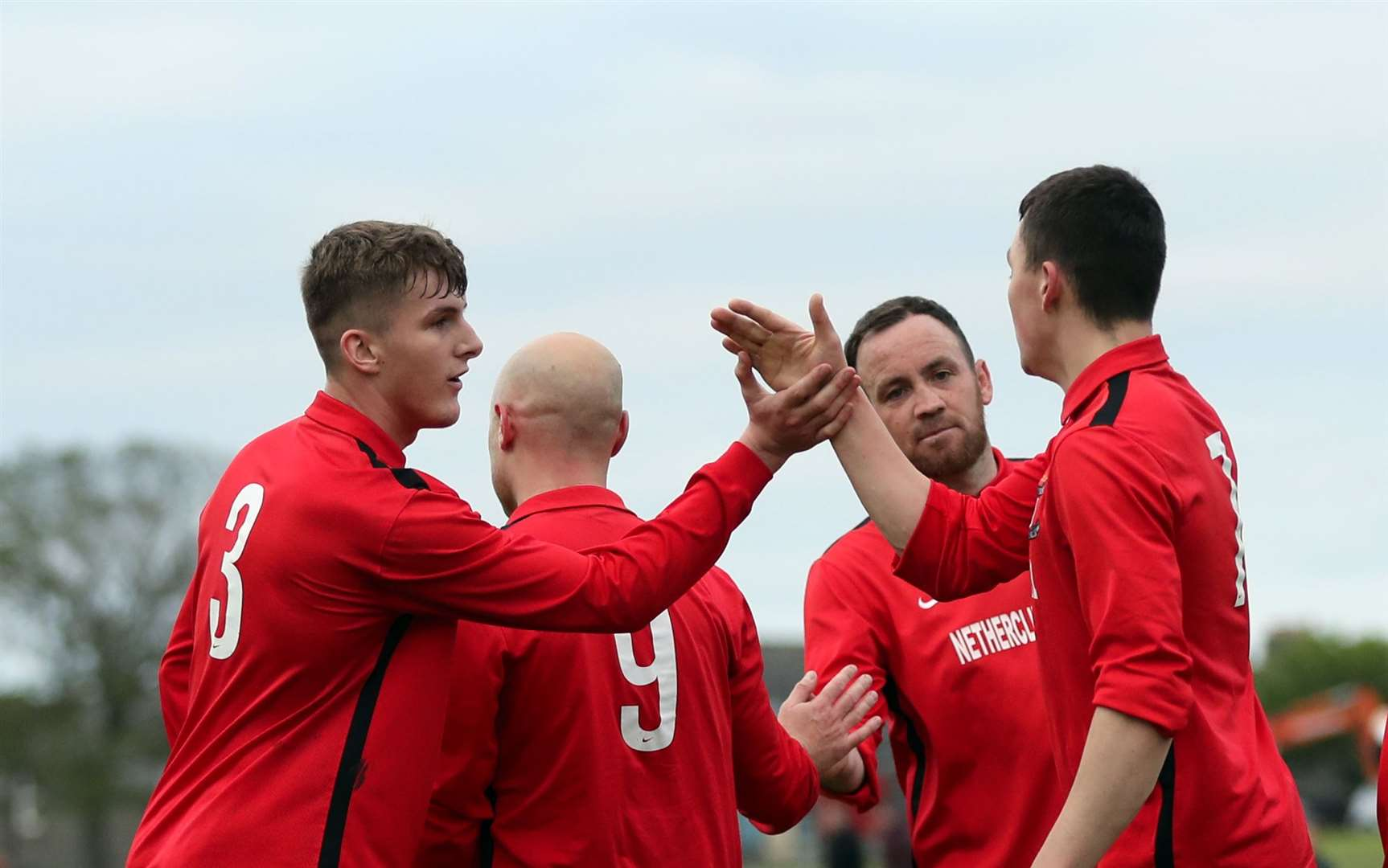 Brandon Sinclair (number 3) congratulates Ryan Campbell on scoring Groats' third goal against Acks. Picture: James Gunn