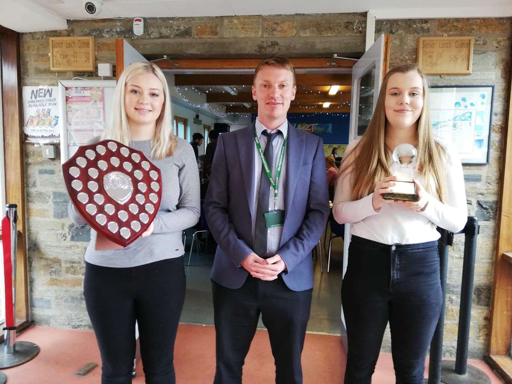 Anna (left) and Alix are pictured with Andrew Rathie, faculty head of social subjects.