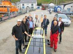 The international TURNKEY project team with their hi-tech device in Scrabster before its launch.