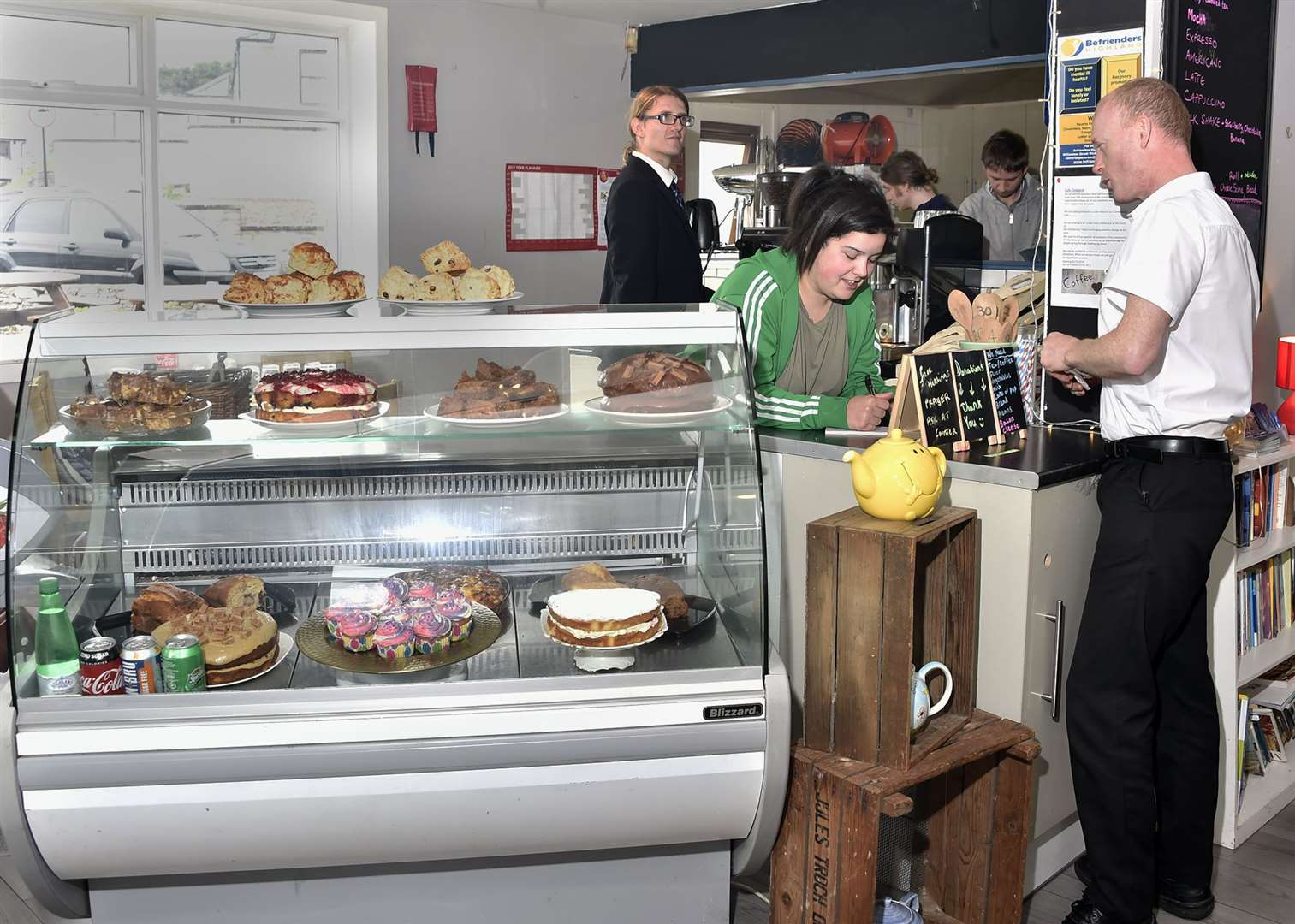 Volunteer Shannon MacPhee serving a customer in the café at Thurso harbour.