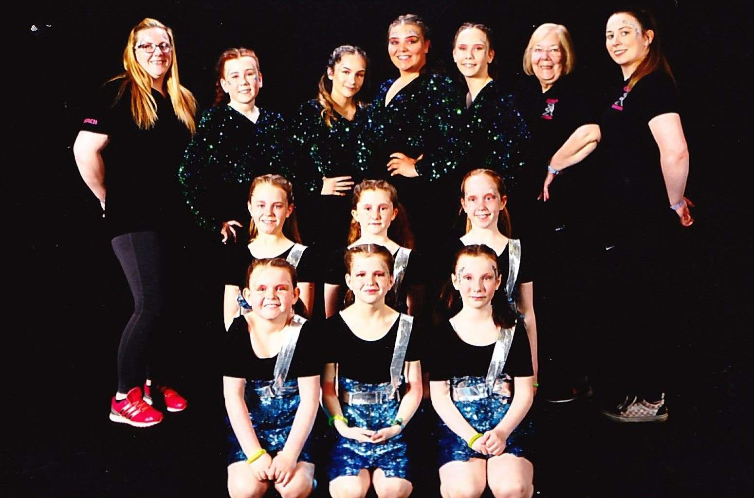 Caithness Rhythmic gymnasts who performed at Gymfest 2019 at Ravenscraig Regional Sports Facility, along with their coaches. Back row, from left: Alana McPhee, Ami Alexander, Edythe Cottam, Megan Wright, Abby Scott, Diane Gibson and Sine Hamilton (coaches). Middle row: Mazie McCulloch, Bethan Wood and Ellie McCulloch. Front: Zara Smith, Carys Gunn and Paige McPhee.