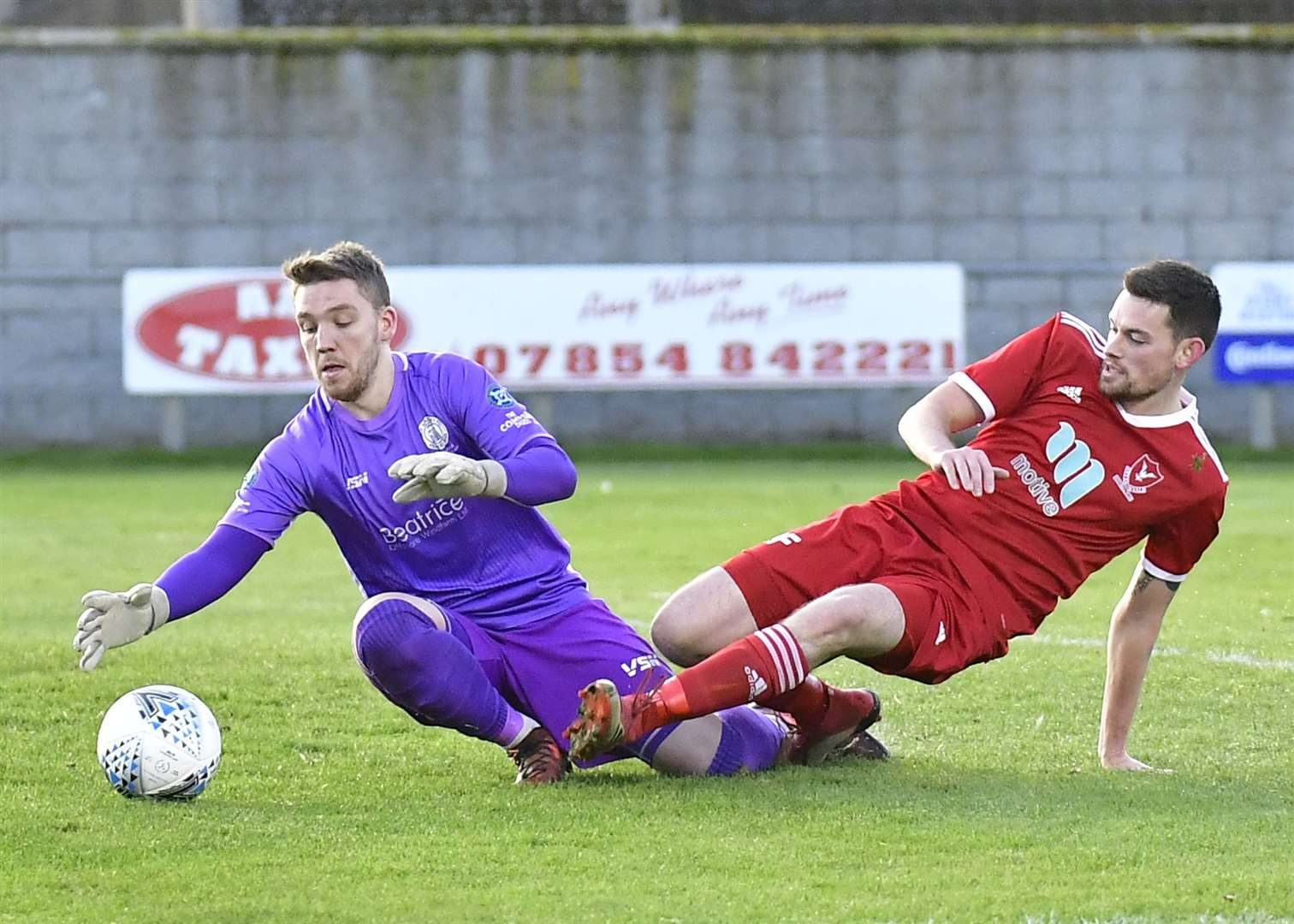 Wick Academy goalkeeper Sean McCarthy pounces on the ball to deny Deveronvale's Colin Charlesworth. Picture: Mel Roger