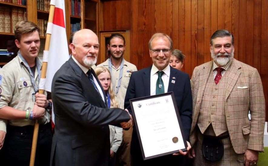 Chairman of the Thurso-Brilon town twinning and friendship committee, Tony Hagon at left, receives a commemoration certificate from the burgomeister of Brilon, Dr Christof Bartsch, accompanied by the Lord-Lieutenant of Caithness and members of the Brilon scout troop. Picture: Georg Witteler