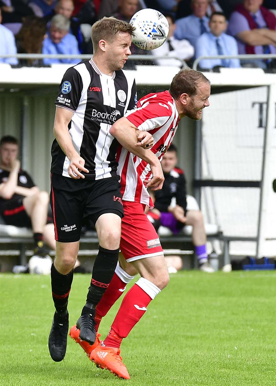 Alan Farquhar heads clear from Formartine United's Garry Wood at Harmsworth Park in August 2019. Picture: Mel Roger