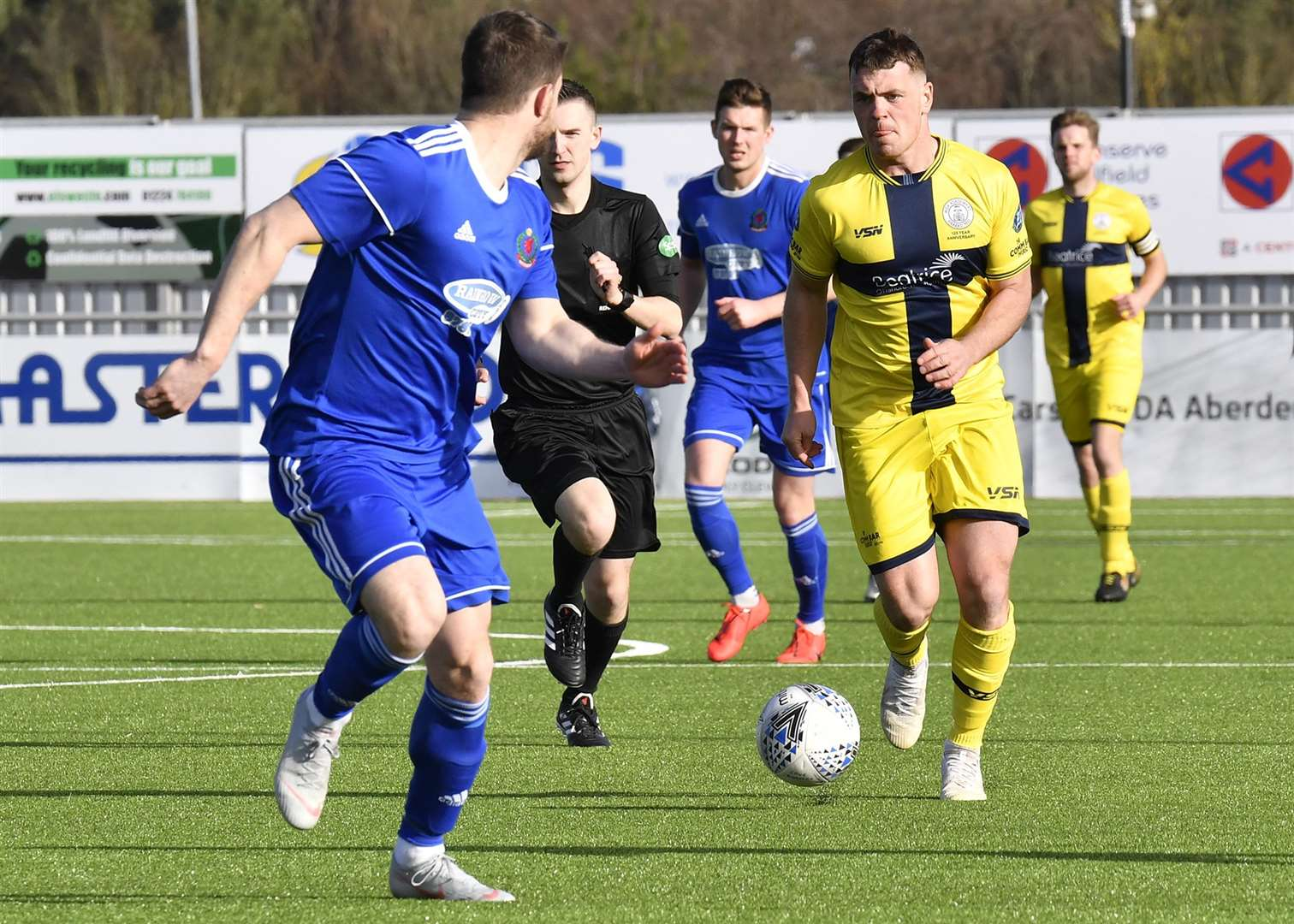 Gordon MacNab takes on Cove's Darryn Kelly at Balmoral Stadium last Saturday. MacNab is one of a number of key players who will miss out on Wick Academy's trip to Rothes this weekend. Picture: Bob Roger