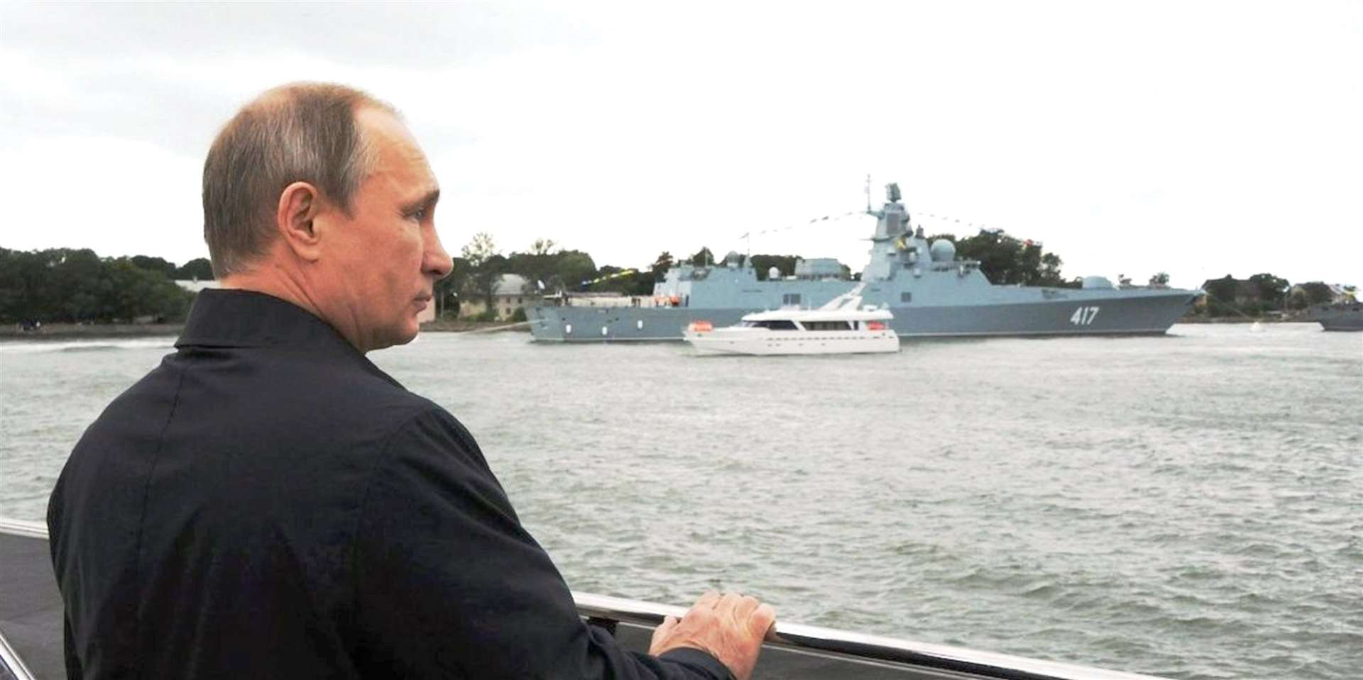 Vladimir Putin inspects The Gorshkov, which was seen off the Caithness coast last week.