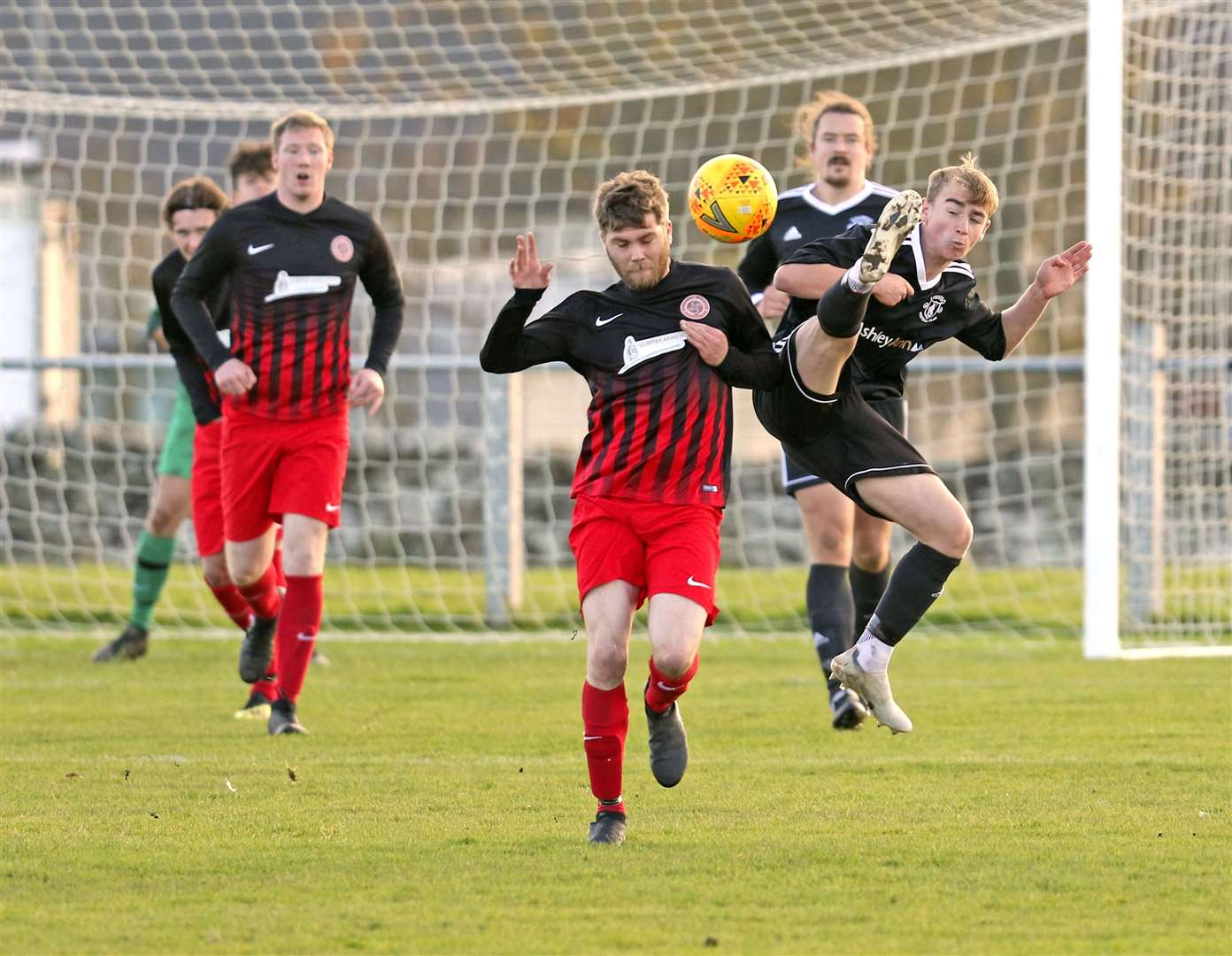 Thurso's Cameron Montgomery in full flight against Chris Green of Halkirk United in a North Caledonian League derby in October 2020. Picture: James Gunn