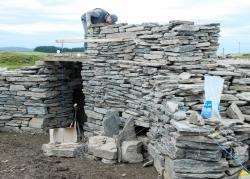 The section of broch in the process of being built. However, the planned collapse produced a surprise result.