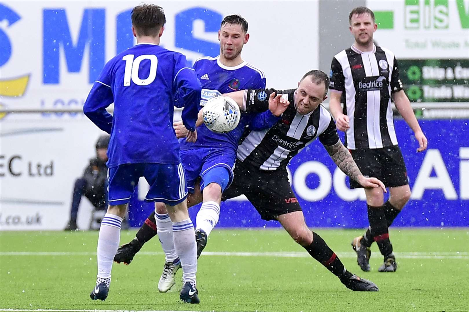 Wick Academy's Danny Mackay tussles with Cove striker Mitch Megginson during last season's semi-final at Balmoral Stadium. Picture: Mel Roger