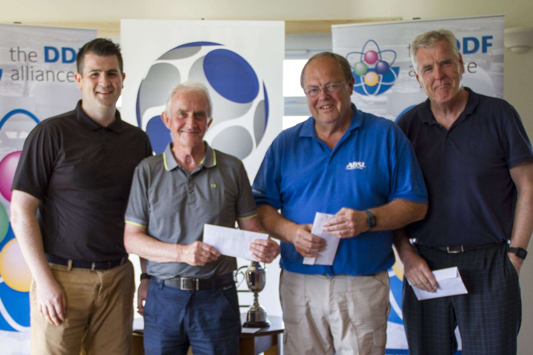 Team winners Fred Groves, Mike Halliday and Alex Anderson receiving their prizes from Loren Jones.