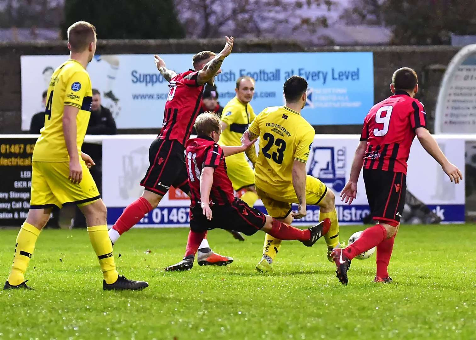 Inverurie's Jamie Michie goes 'loco' as he hacks down Wick's Sam Mackay from behind. Michie saw not one but two red cards after this incident. Picture: Mel Roger