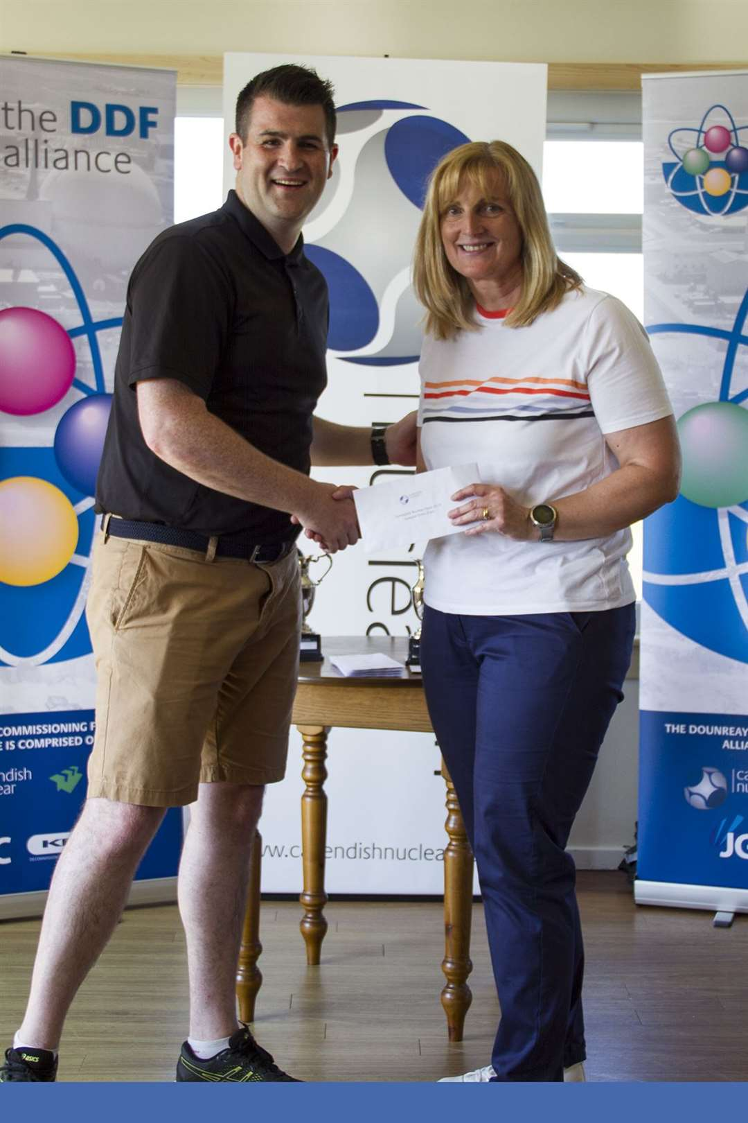 Individual winner Carol Paterson receiving her prize from Loren Jones (Cavendish Nuclear).