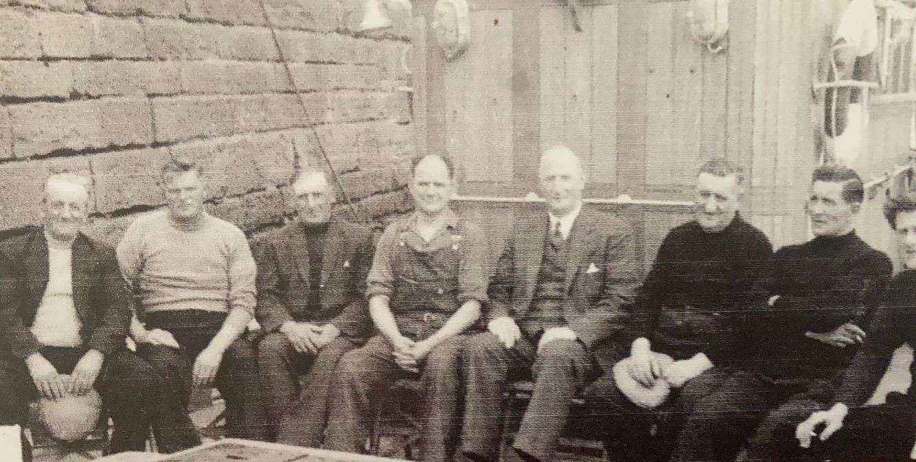 The crew of the Primula on Stroma on the day of the picnic. From left: Dan Wares, an ex-Stroma man, Alex Thompson, Malcolm Simpson, another former Stroma man, Bennie Sinclair, Thurso provost John Sinclair and joint owner of the boat, skipper Angus MacIntosh, Billy (Borax) Mackay and Donny Latimer, deckhand.