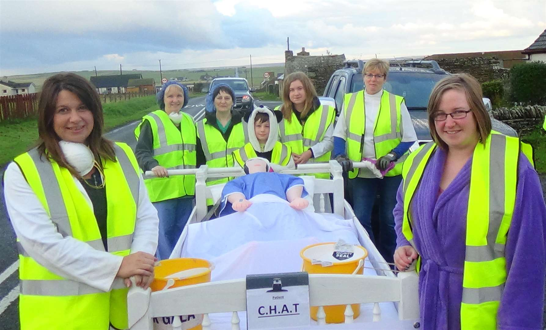 Miriam Sutherland (back right) with the Carry on Caithness team. She said its vital health services in Caithness are maintained due to the county's ageing population. Photo: Will Clark