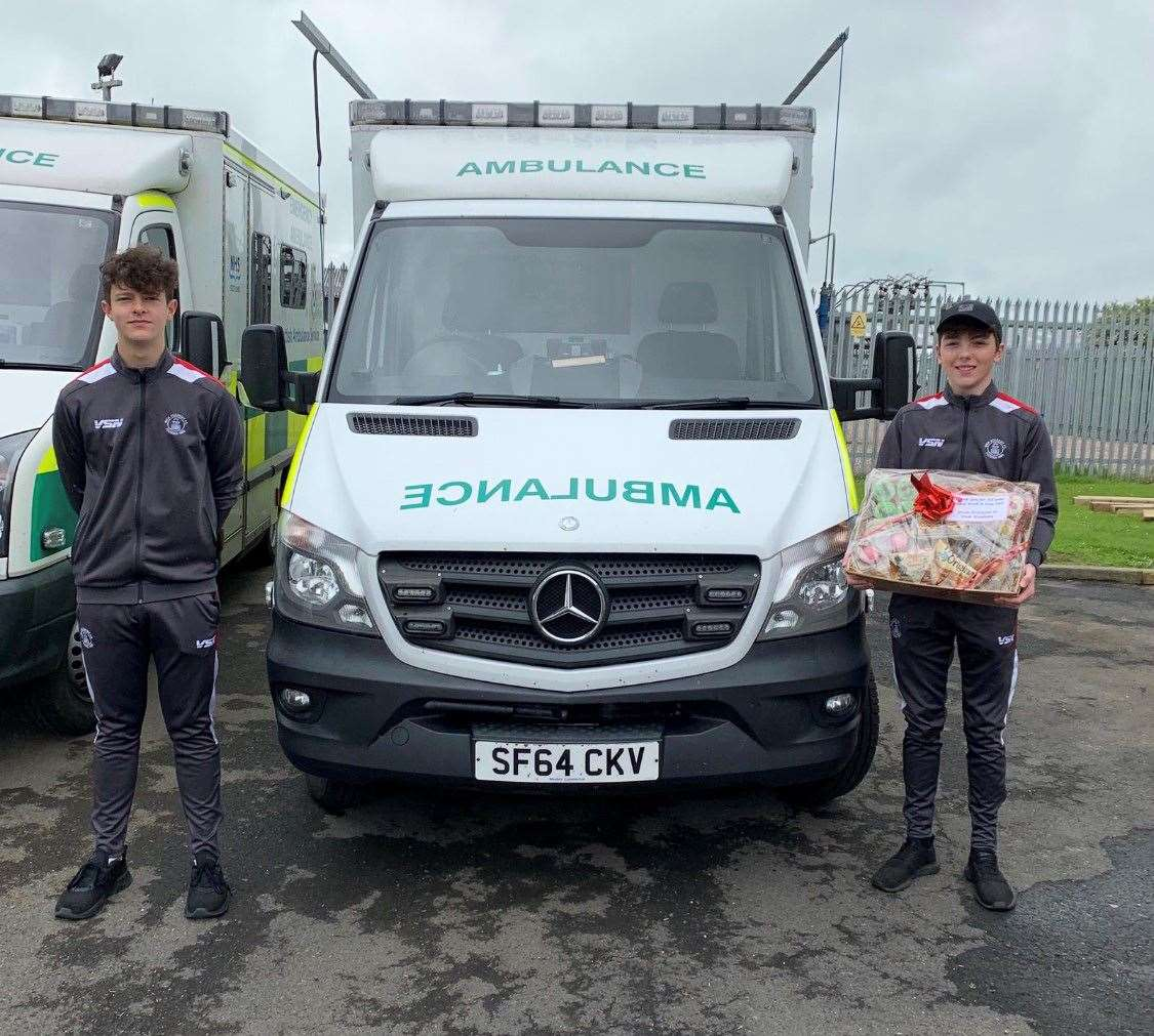 Lewis Gallagher and William Cannop delivering the hamper for the ambulance team at Thurso.