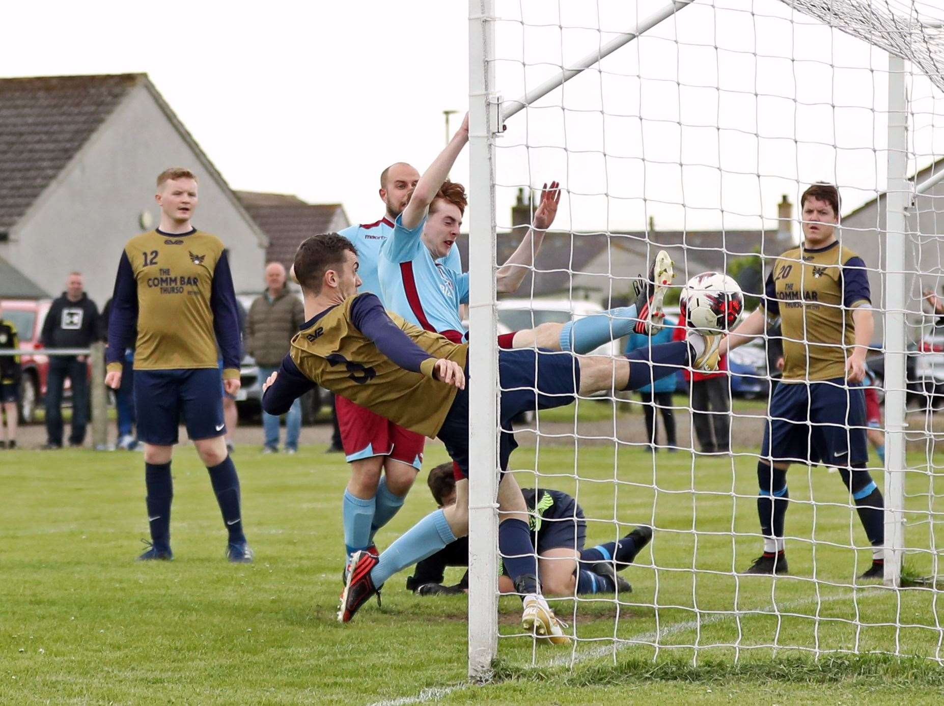 Pentland United's Roddy Innes forces the ball over the line to score equaliser, despite the efforts of High Ormlie Hotspur defender Ian Ross. Picture: James Gunn
