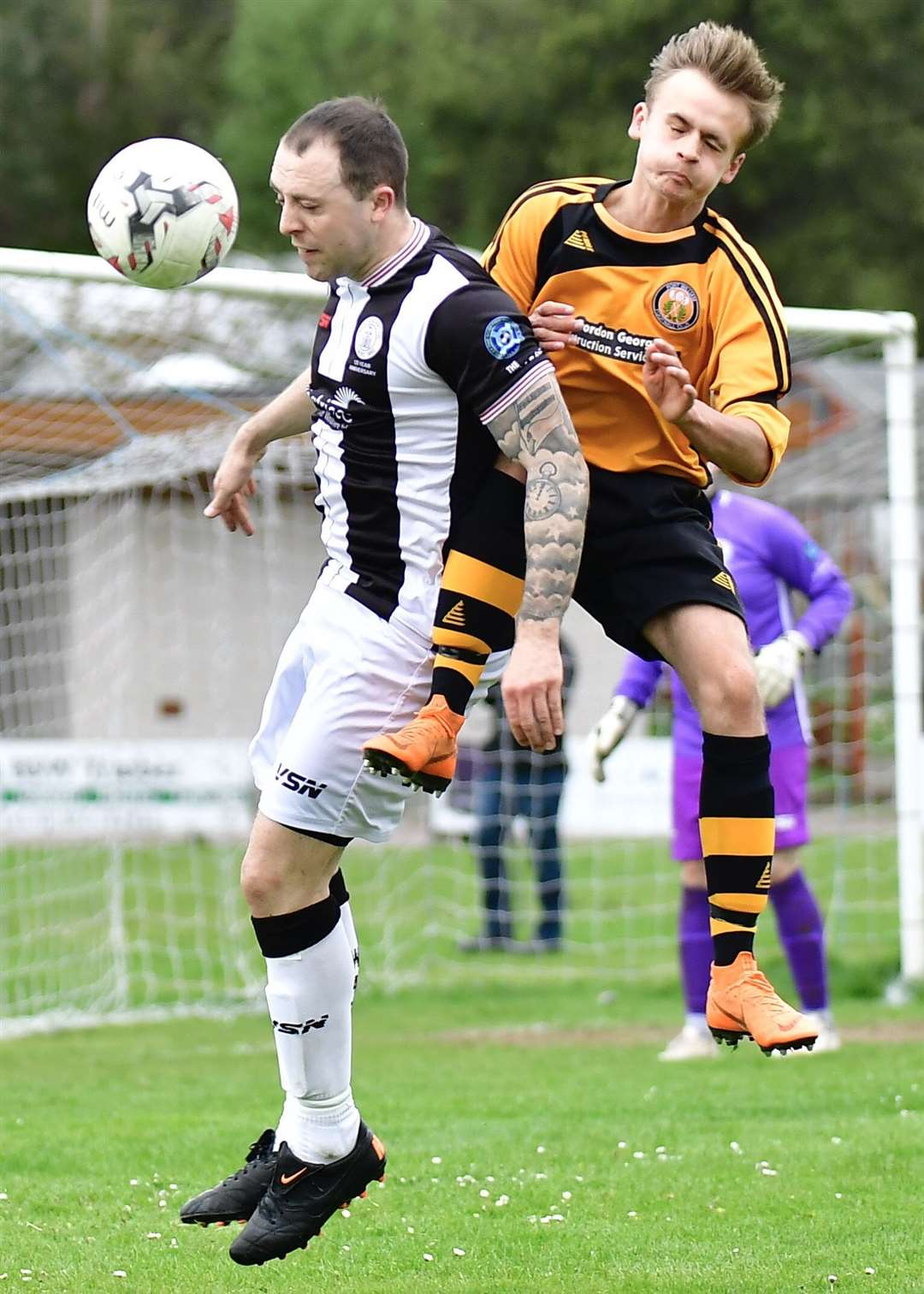 Fort William's Jordan Andrew crashes into Wick's Danny Mackay to earn his second yellow card of the afternoon. Picture: Mel Roger